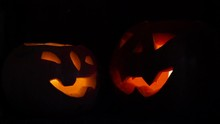 Two Halloween Pumpkins,two Pumpkins Are Lit At Halloween Time At Night