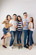 canvas print picture - Full-length portrait of young Vietnamese people posing for photo in studio