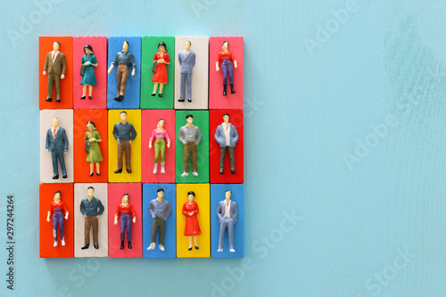 Fotomural  business concept image of people figures over wooden table, human resources and