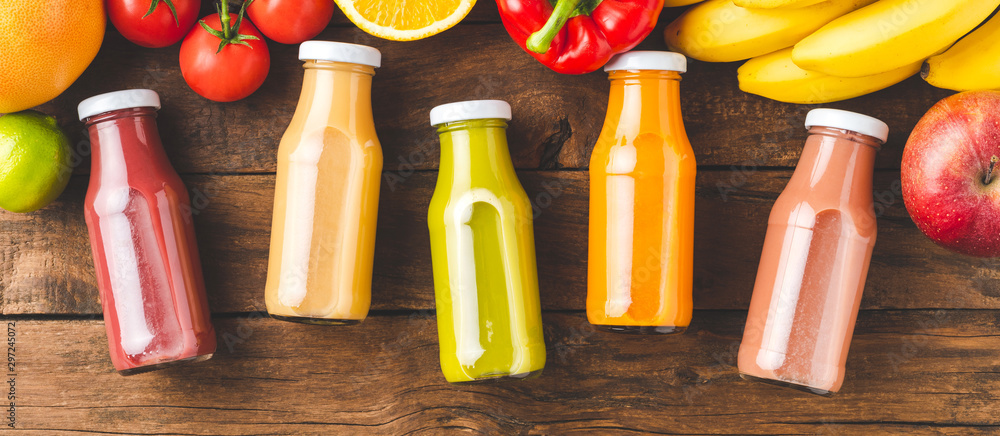 Fototapety, obrazy: Multicoloured juices in bottles on old wooden background with fruits and vegetables. Top view. Banner