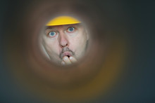 Male Plumber Looks Into Contam...