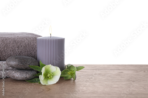 Carta da parati  Composition with spa stones and candle on wooden table against white background