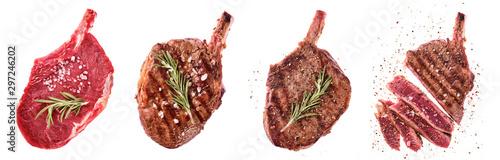 Fototapeta Rib eye steak. Entrecote on the bone. Raw, fried and sliced steaks obraz