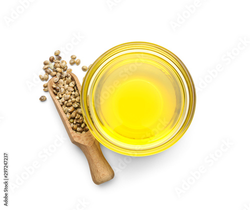 Obraz Bowl with hemp oil and seeds on white background, top view - fototapety do salonu