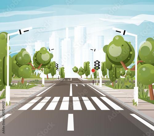 Foto Empty Road with Crosswalk, Road Markings, Sidewalk for Pedestrians, Trees and Traffic Lights