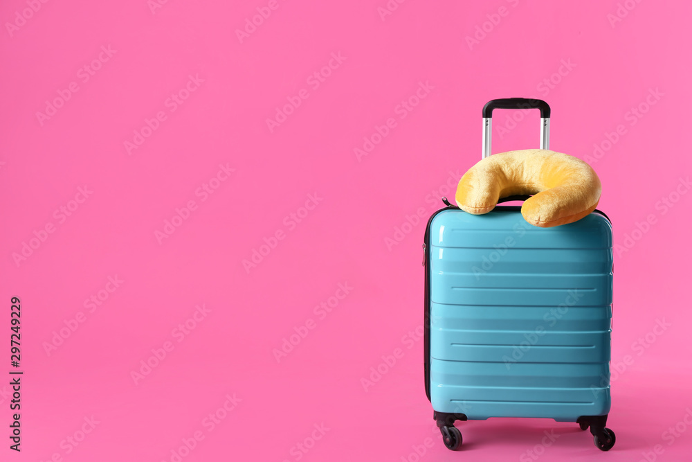 Fototapety, obrazy: Turquoise suitcase and travel pillow on pink background, space for text