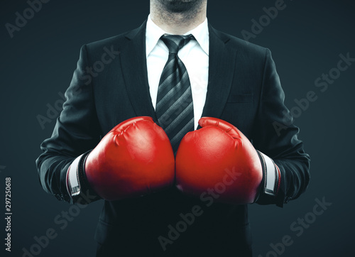 Fototapety, obrazy: Businessman in red boxing gloves