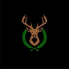 Deer Head With Big Antlers In Laurel Wreath Icon Isolated On Black Background