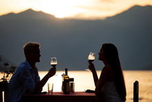 Couple Sharing Romantic Sunset...