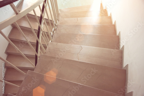marble stairs lit by rays of morning bright sun in modern house
