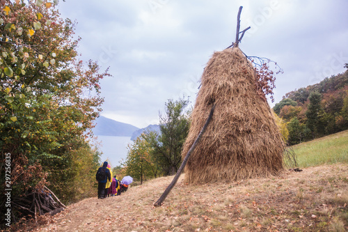 Fototapeta Traditional haystack at the rural farmland on an autumn day