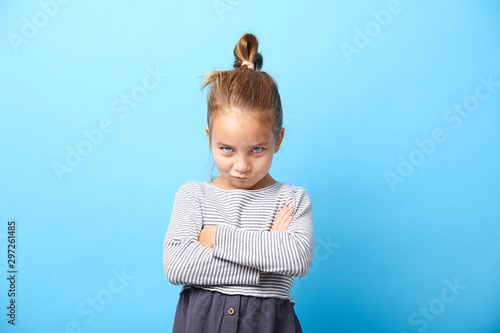 Offended little girl crosses her arms and makes a disgruntled expression of protest Wallpaper Mural