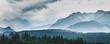Leinwanddruck Bild - Mountain peaks in clouds and fog. Tatra Mountains, Poland.