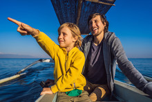 Father And Son Travelers Meets Dawn In The Sea On A Boat