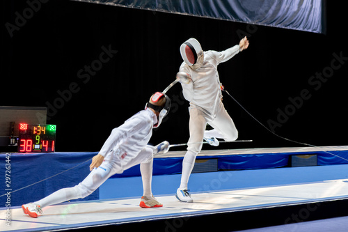Fotomural Fight at a fencing competition.