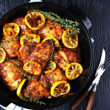 Chicken Thighs With Lemon Slices In A Pan