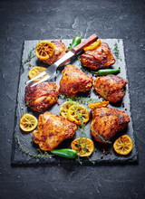 Chicken Thighs With Lemon Slices On A Stone