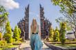 Leinwanddruck Bild - Young woman tourist in budhist temple Brahma Vihara Arama Banjar Bali, Indonesia