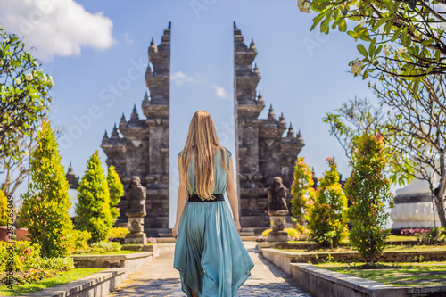 Spoed Fotobehang Bedehuis Young woman tourist in budhist temple Brahma Vihara Arama Banjar Bali, Indonesia