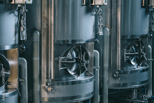 Leinwand Poster Craft beer brewing equipment in brewery! Metal tanks, alcoholic drink production