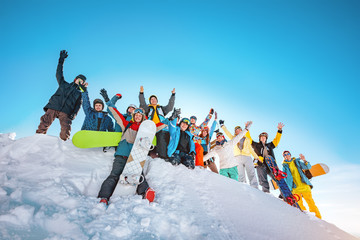 Big group of skiers and snowboarders at ski resort