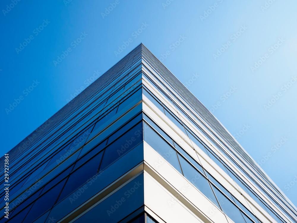 Fototapeta Architecture detail Modern Building Glass facade Corner Blue sky Background