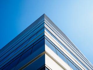 Architecture detail Modern Building Glass facade Corner Blue sky Background