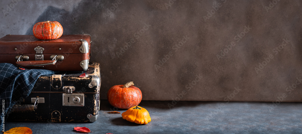 Fototapety, obrazy: Autumn travel concept. Vintage old fashioned Suitcases with pumpkins and autumn leaves on dark background. Banner, travel agency. Copy space