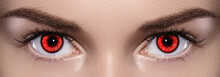 Close-up Of Woman Eyes. Halloween Makeup. Devil, Vampire Or Monster Eye Lens. Luminous Red Eyes