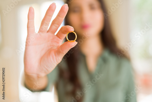 Close up of woman smiling showing golden alliance wedding ring Canvas Print