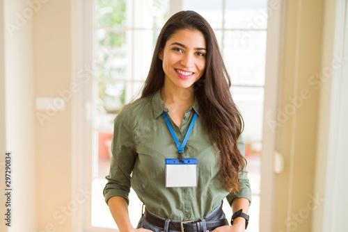Pinturas sobre lienzo  Beautiful young business woman wearing id card