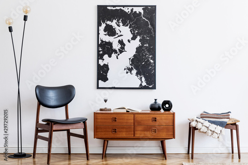 Obraz Stylish and retro living room with design vintage wooden commode, chair, footrest, black lamp and elegant personal accessories. Mock up poster map on the wall. Template. Vintage home decor.  - fototapety do salonu