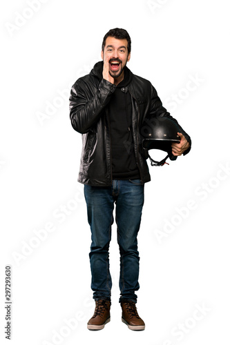 Autocollant pour porte Kiev Full-length shot of Biker man shouting and announcing something over isolated white background