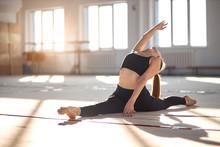 Gorgeous Charming Lady Training And Stretching In Big, Bright Room, Rhythmic Gymnastics Concept