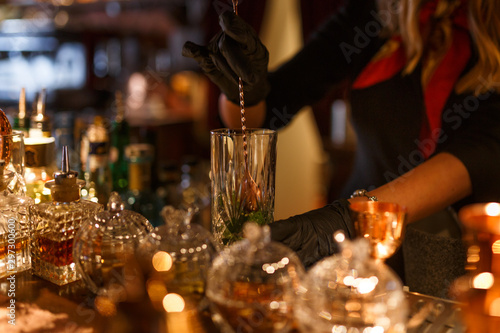 Bar Cropped view of cocktail Preparation. The barman is preparing a drink.