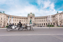 Hofburg Palace And Heldenplatz With A Passing Carriage With A Pair Of Horses, Vienna, Austria