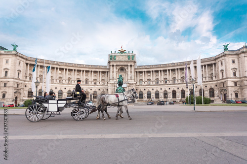 Photo  Hofburg Palace and Heldenplatz with a passing carriage with a pair of horses, Vi