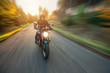 canvas print picture - Motorcycle driver with blurred motion effect