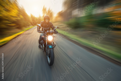 Motorcycle driver with blurred motion effect Fotobehang