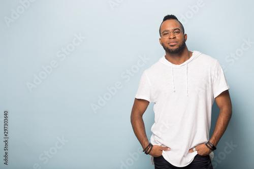 African American man in glasses posing in studio