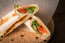 Salmon Tortilla On Baking Paper With Peppercorns