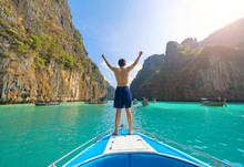 An Asian Man, A Tourist, Standing On A Boat To Snorkeling Or Diving In Krabi With Blue Turquoise Seawater, Phuket Island In Summer Season During Travel Holidays Vacation Trip. Andaman Ocean, Thai