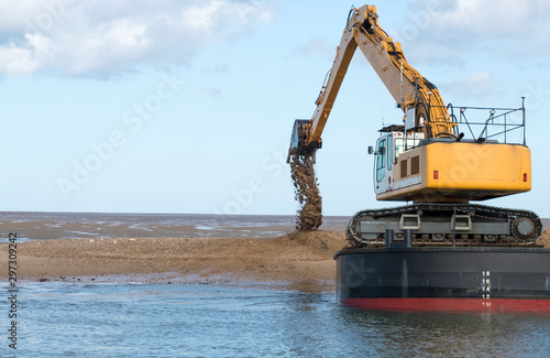 Fotografia, Obraz Dredger dumping sand on a bank