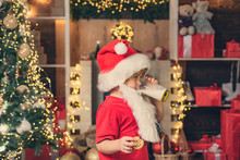 Santa Claus Enjoys Cookies And Milk Left Out For Him On Christmas Eve. Santa Fun. Funny Child Christmas.