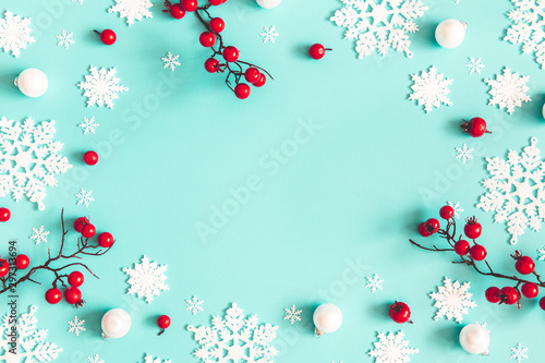Poster Countryside Christmas or winter composition. Snowflakes and red berries on mint background. Christmas, winter, new year concept. Flat lay, top view, copy space