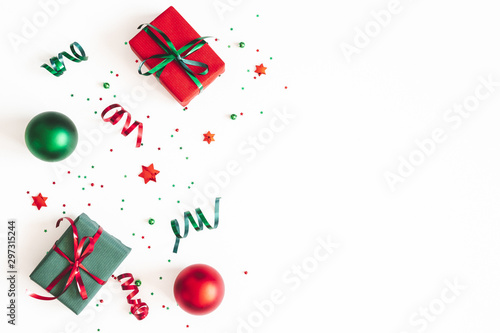 Fototapeta Christmas composition. Gifts, red and green decorations on white background. Christmas, winter, new year concept. Flat lay, top view, copy space obraz na płótnie
