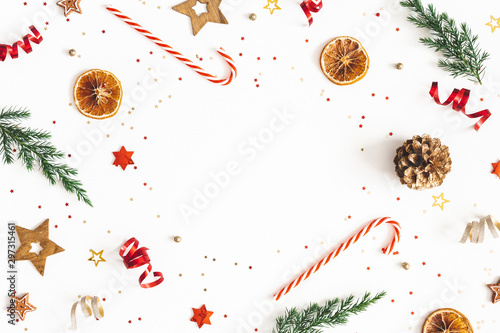 Christmas composition. Fir tree branches, golden and red decorations on white background. Christmas, winter, new year concept. Flat lay, top view, copy space