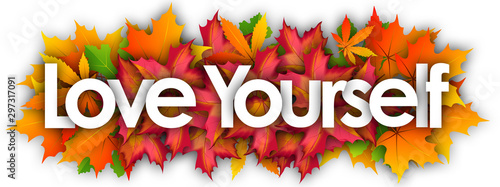 Fotomural  Love yourself word and autumn leaves background