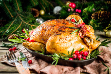 Traditional Christmas And Thanksgiving Roasted Whole Chicken With Fruit And Rosemary. Rustic Wooden Background Copy Space With Christmas Decoration