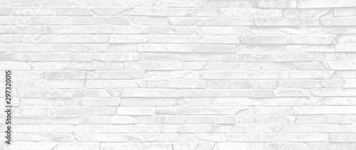 Foto Stacked stone wall texture backround